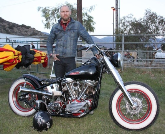 """Kaz,"" lead singer and guitar player for Redlight King, with his 1950 Panhead"
