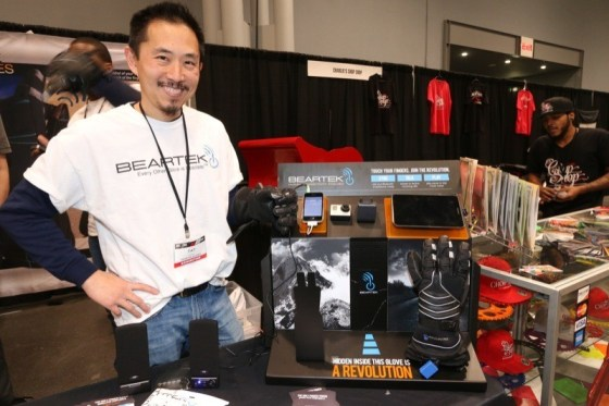 A Beartek rep demonstrates the company's new gloves that wirelessly control your bike's devices