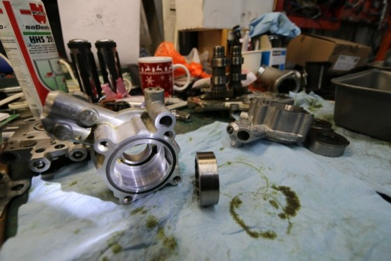 The oil pump and gerotor surfaces were scored by debris passing through the oil circulation system