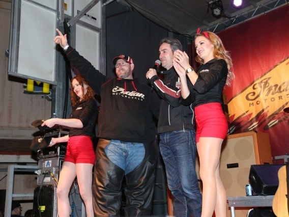 """Mike Wolfe (second from right) congratulates Donnie Donohue (second from left) on winning the Indian Motorcycle """"Epic One-Year Demo Ride"""""""