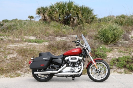 The SuperLow 1200T is the first Sportster to feature factory-equipped saddlebags and windshield as standard gear