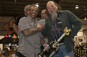 """Bobby James, a.k.a. the """"King of Shine,"""" accepts a Special Recognition Award from Ron Finch for Best Chrome (imagine that!)"""