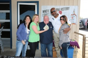 John Mullen donated his Best Hand winnings from the East Carolina Radio Poker Run back to the Outer Banks Hotline