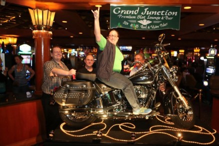 The winner of the Tropicana's Laughlin River Run raffle saddles up on her new Heritage Classic