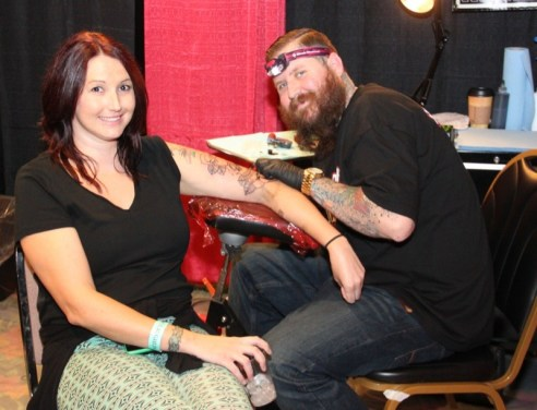 Megan Lloyd Davies gets inked by Dustin from Creepshow Tattoos in Visalia, California at the Laughlin Tattoo Convention in the RIver Palms