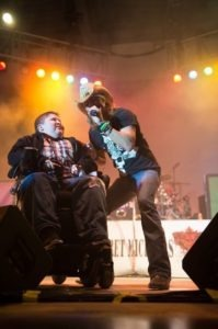 MDA Goodwill Ambassador Bryson Foster joins Bret Michaels onstage during Saturday's concert.