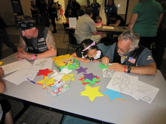 A few bikers show their softer side while coloring with the kids