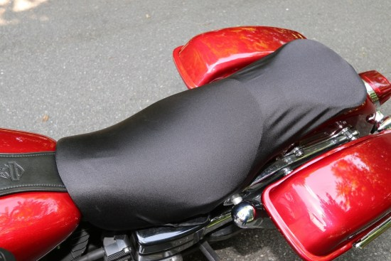 However, if I want to ride the bike with the cover on, I affix it using the hook-and-loop straps, which offer a snugger fit.
