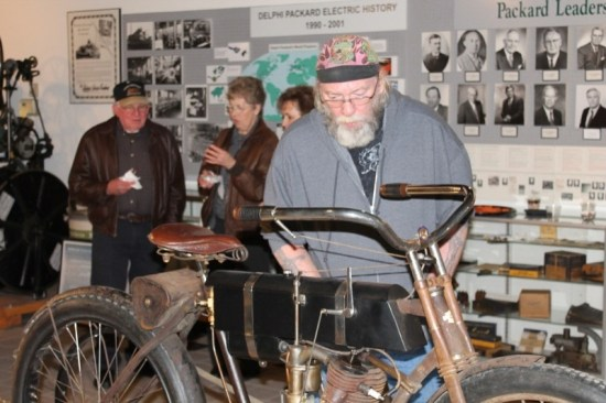 Panhead Pat inspects Bruce Linsday's 1905 Harley-Davidson—the world's oldest running Harley