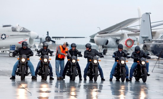 The scene from on the flight deck of the USS Yorktown while six veterans and active-duty military ride the H-D Street 500 as Harley-Davidson announced it is offering current and former U.S. military free Riding Academy motorcycle training. (Mic Smith/AP Images for Harley-Davidson)