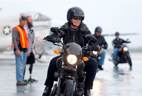 Debi Cole, from James Island, S.C., rides the H-D Street 500 aboard the USS Yorktown, in Mt. Pleasant, S.C., as Harley-Davidson announced it is offering free Riding Academy to all current and former U.S. Military. (Mic Smith/AP Images for Harley-Davidson)