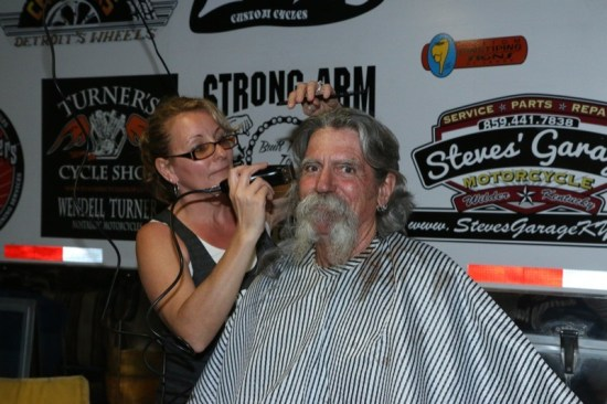 """""""Mailman"""" Kevin O'Brien has his locks sheared at Cacklebery Campground to benefit the Aidan Jack Seeger Foundation"""