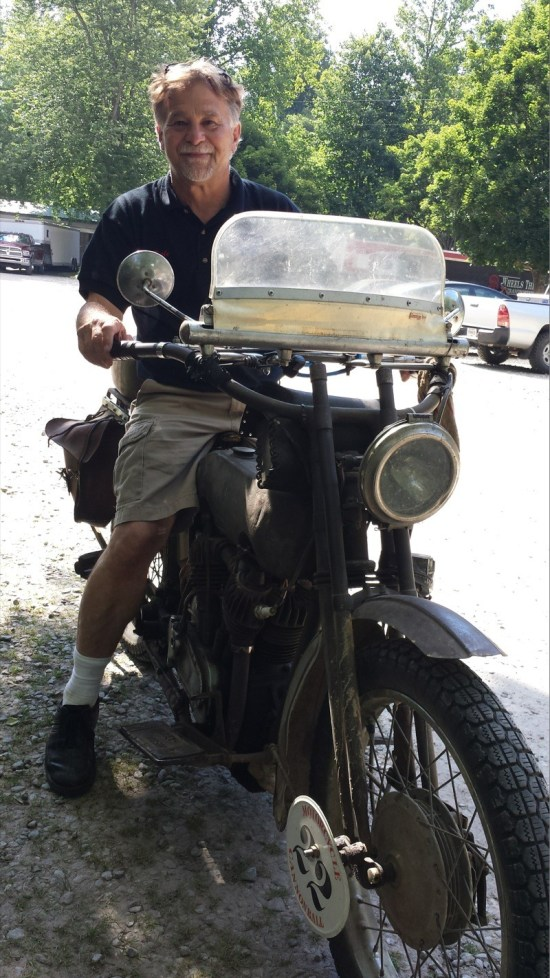 Dale Walksler riding one of his bikes on display at the Wheels Through Time Museum