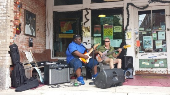15-year-old Kingfish (left) plays some mean blues in front of Cat Head Delta Blues & Folk Art