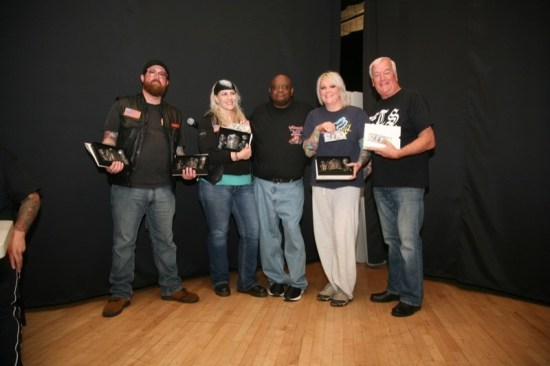 Emcee Herb Ross (center) presents the tattoo contest winners: Evan Lewis (far left), Best of Show and Best Black and Gray, Pinky Grisko (center left), Best Fresh, Kim (center right), Best Color and Peter James, Best Tribal