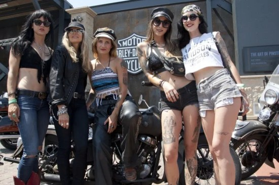 Karen Davidson (second from left) hosted a fashion show with young female riders at the newly opened Rally Point pavilion in downtown Sturgis