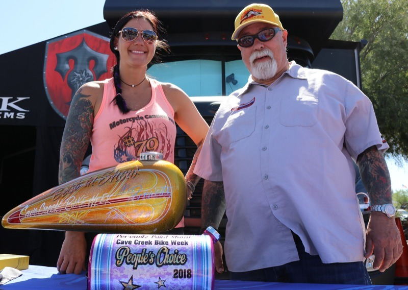 Father/daughter painters Jodi and Dave Perewitz hosted a paint contest on Saturday at the Road House with hand built awards. Jodi's custom paint work adorned the purple People's Choice tank (foreground), with Dave's handiwork gracing the Best of Show yellow tank.