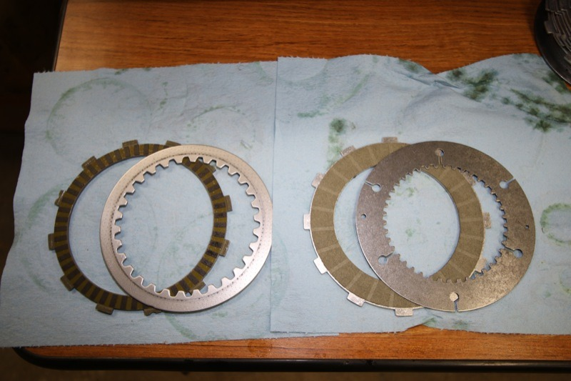 The stock assist-and-slip clutch (l.) has nine friction plates and eight steel plates while the Bandit Sportsman Superclutch (r.) features 11 friction plates and 10 steel plates that are slightly thinner and have more surface area than the stock plates