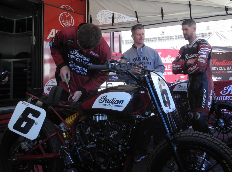 Brad Baker discussing set up and a mechanic makes last minute adjustments before practice at Daytona