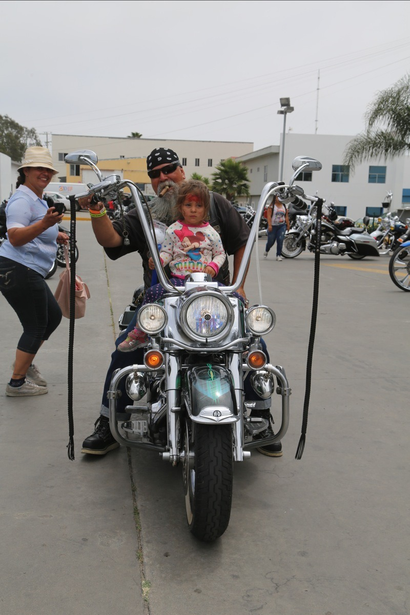 Pio Hollywood Hernandez gave this girl and her mother (left) the thrill of their lives. A future biker is born.