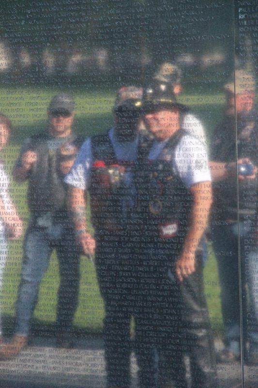 Two Vietnam Vets reading the names of their lost comrades