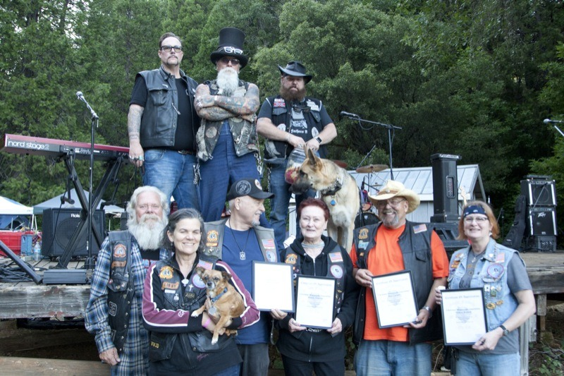 GFMC prez, Crayz Alexander (top center) and the NorCal club presented members of the Christian Motorcycle Association with plaques in appreciation for the selfless work they do to help out during the campout