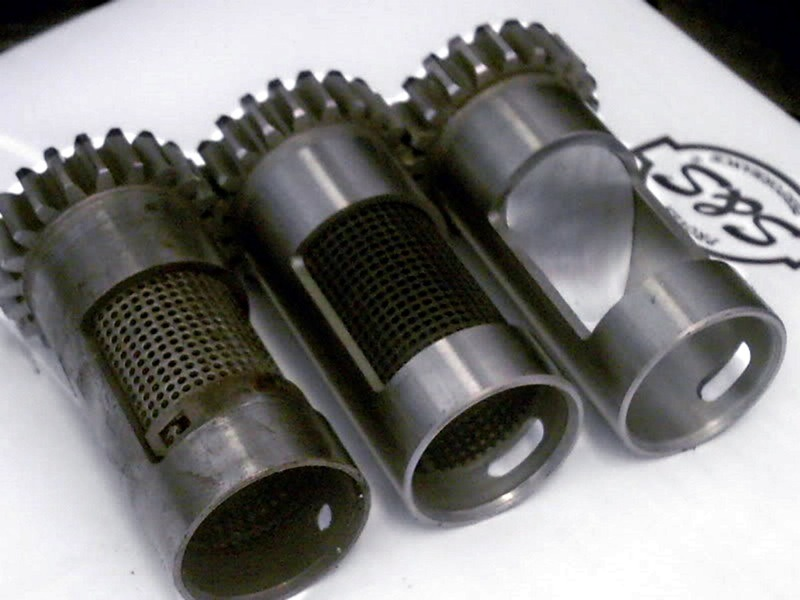 Figure 1: S&S has been at this breather design stuff for a long time and has rotary as well as reed styles. Aside from the steel vs. plastic debate, this photo shows the varied detail approaches to conventional breathers. Using a slot rather than a hole at the case end of the breather is supposed to give the crank more time to suck oily air back into its case… mere thousandths of a second at high rpm. Different holes for different souls, implying H-D engines, depending on displacement and state of tune… actually breathe with varied degrees of effectiveness.