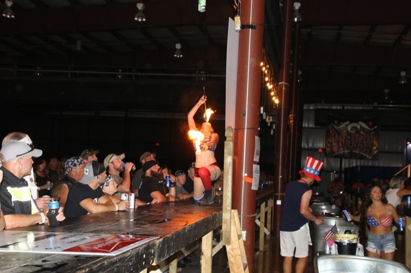 Fire-eating girl at Coal Bucket Saloon