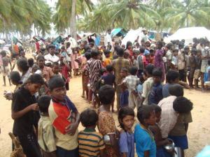92b-masses trapped phoca_thumb_l_Children waiting to get kanchchi at TRO center..