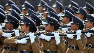 Sri Lankan women police officers march during a Victory Day parade in Matara, about 165 kilometers (103 miles) south of Colombo, Sri Lanka, Tuesday, May 19, 2015. Sri Lanka's government Tuesday marked the sixth anniversary of the civil war victory over ethnic Tamil separatists. (AP Photo/Nishan Priyantha)