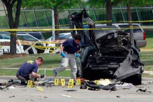 """GARLAND, TX - MAY 4, 2015 : FBI investigators work a crime scene outside of the Curtis Culwell Center in Garland, Texas on Monday, May 04, 2015 after a shooting occurred the day before on May 03, 2015 during the """"Muhammad Art Exhibit and Cartoon Contest"""" in Garland, Texas. (Photo by Ben Torres/Getty Images)"""