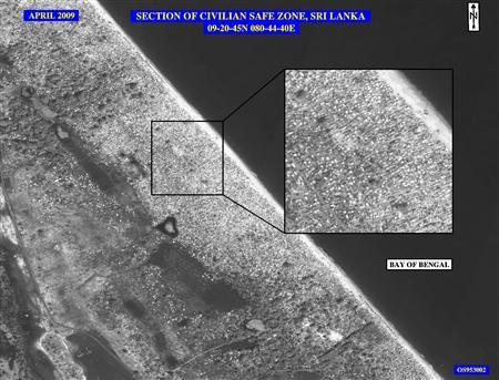 """This April 2009 image released by the State Department shows the civilian """"safe zone"""" in northern Sri Lanka, the heart of the conflict between the Tamil Tigers and the Sri Lankan forces, after the civilians, estimated by the United States to be more than 100,000, were herded on to the beach. REUTERS/US National Imagery Systems/Handout"""