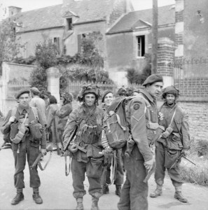 Commandos of No. 4 Commando, 1st Special Service Brigade, and troops of 6th Airborne Division in Bénouville after the link-up between the two forces, 6 June 1944. B 5058 Part of WAR OFFICE SECOND WORLD WAR OFFICIAL COLLECTION No 5 Army Film & Photographic Unit Evans, J L (Capt)