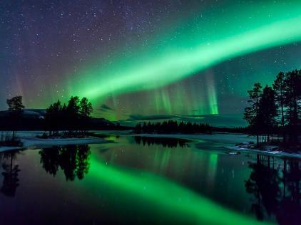 Aurora over Arjeplog, Lapland, Sweden - photo by Maria Sundqvist