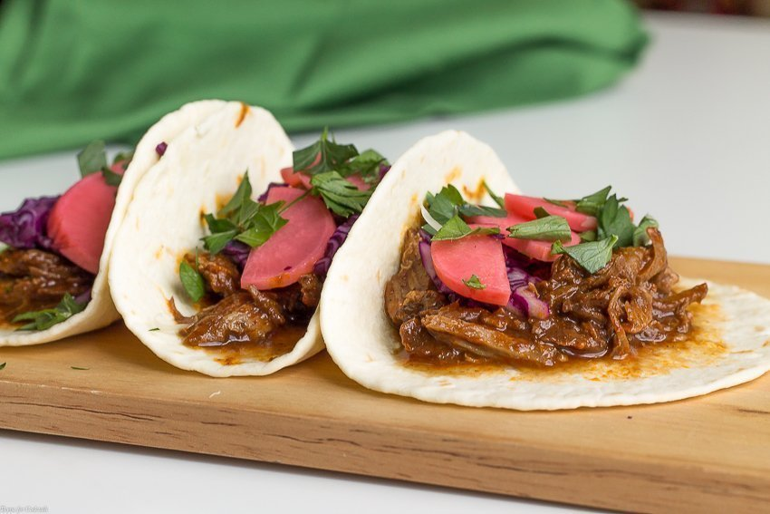 Taco Tuesday doesn't have to be difficult when you make these Slow Cooker Pork Mole Tacos for dinner this week. Top with pickled radishes for a spicy crunch.