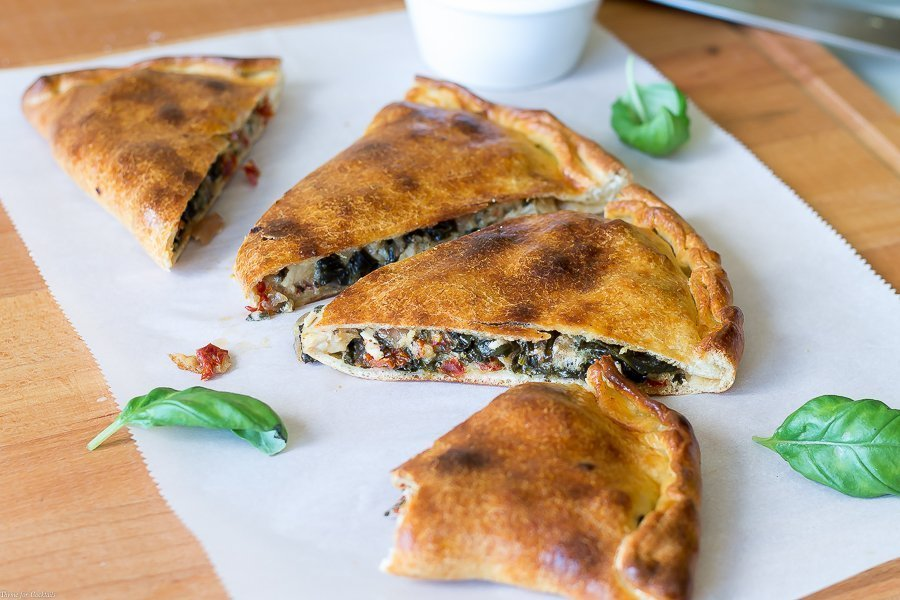 Every bite of thisSun Dried Tomato Basil Chicken Calzone recipe is so full of authentic Italian flavors you can't help but feel like you are dining in a classic pizzeria.