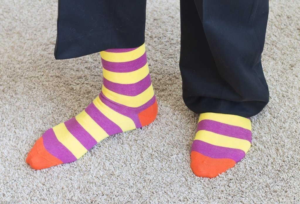 man wearing purple and yellow striped socks - Crush Your New Year's Goals + Cue Vapor