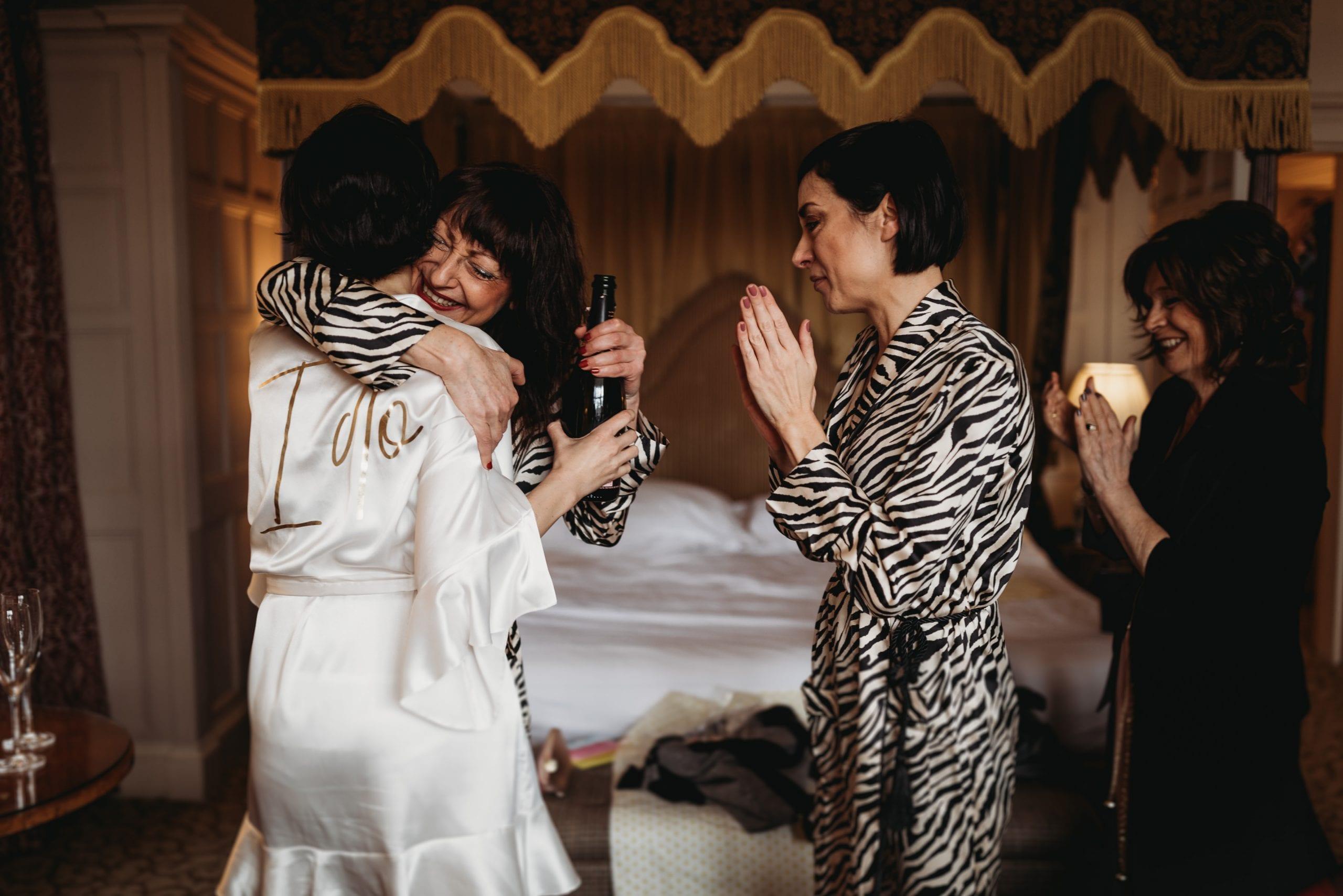 bridesmaid hugging bride at getting ready