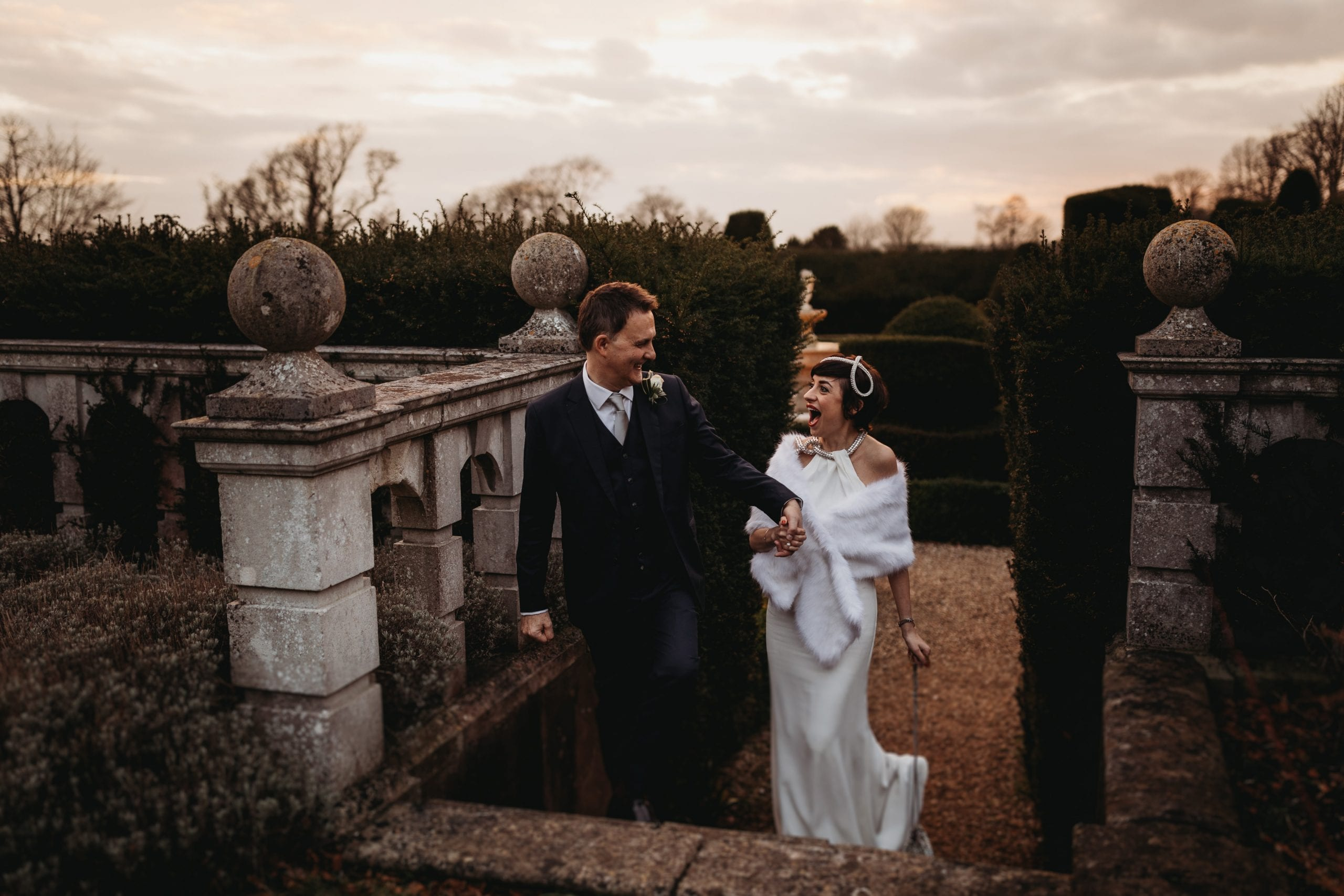 bride and groom walking at a portrait of bride and groom at a Danesfield House wedding