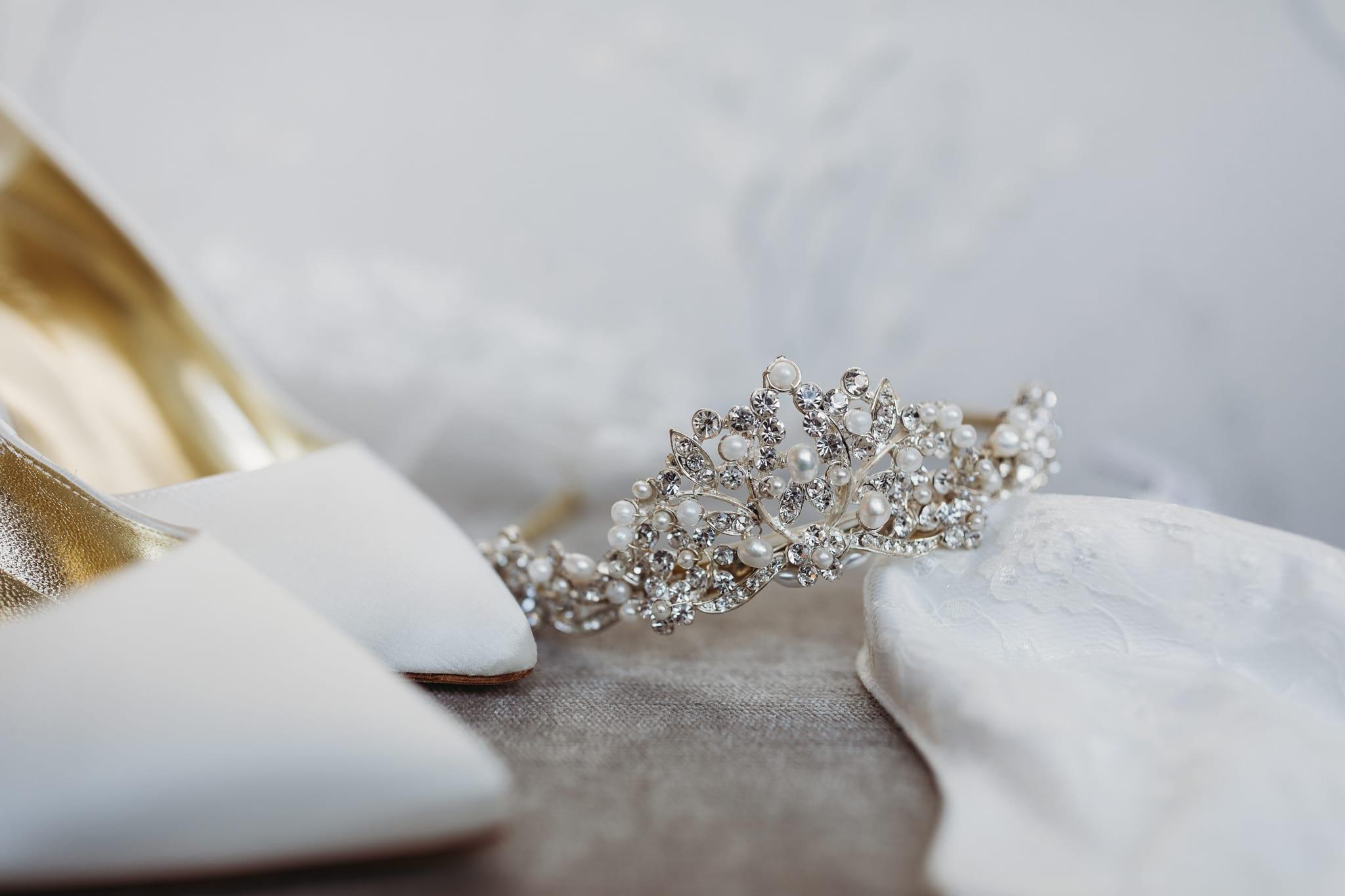 closeup of wedding tiara and bridal shoes