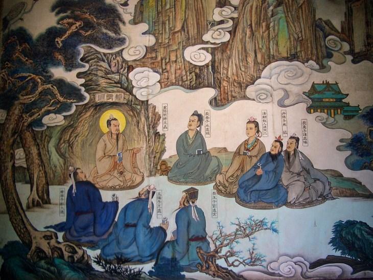Wang Chongyang et Bei Qizhen. La personne assise au milieu est Wang Chongyang. Qiu Chuji est le premier à gauche