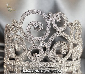silver tiara made of metal and rhinestones
