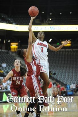 Tia going up for a layup