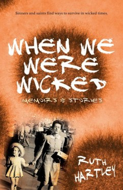 The book cover of 'When We Were Wicked', a book of short stories by Ruth Hartley. The title in white text appears to be painted across an orange background. This background colour recedes at the bottom left of the book to reveal an old black-and-white photograph  of a woman holding the hand of very young girl in a short dress and straw hat on a busy street.