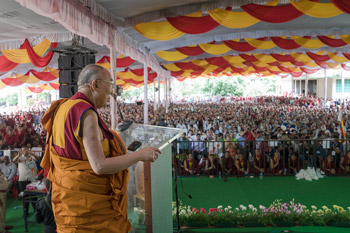 His Holiness the Dalai Lama speaking to the crowd of more that 14,000 during celebrations to mark his 81st birthday in Mundgod, Karnataka, India on July 6, 2016. Photo/Tenzin Choejor/OHHDL