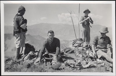 Mission staff having a picnic in the hills above Lhasa