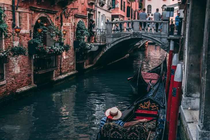 photo of man riding canoe