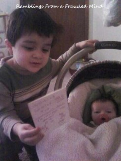 Big brother reading to little sister