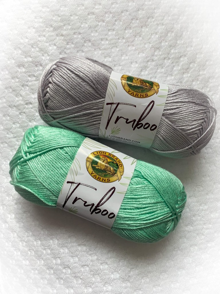 photo of lioinbrand truboo yarn in green and grey