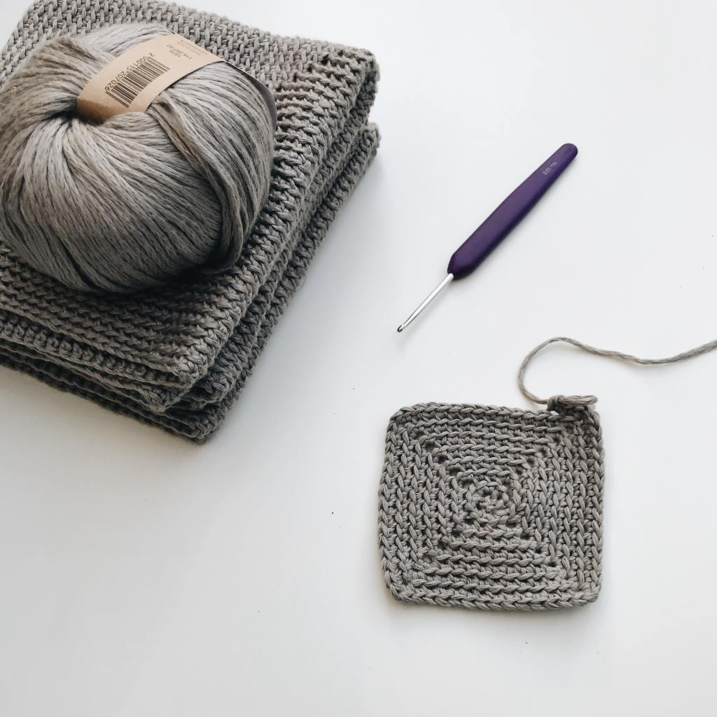 virtual isolation photo of crochet square and yarn
